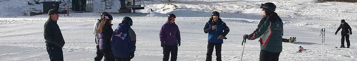 A ski instructor with a group of students.