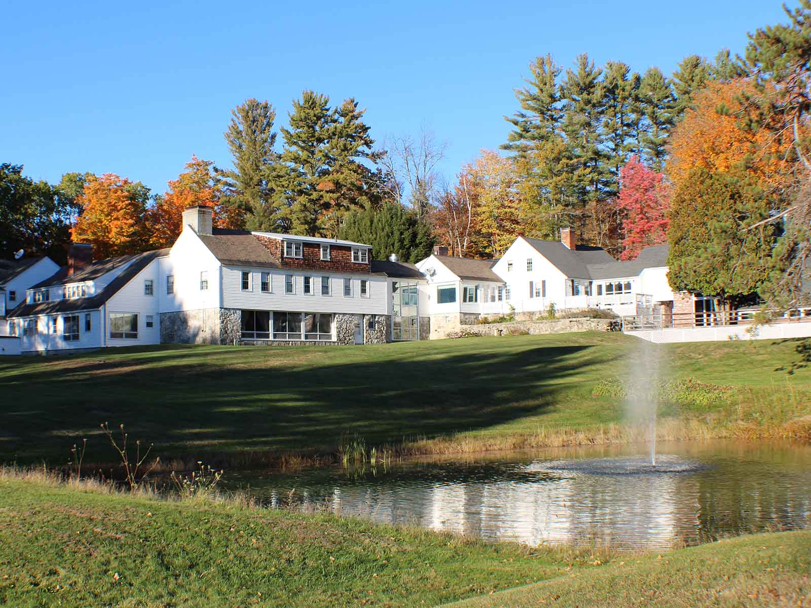 The scenic New Hampshire Mountain Inn with fall foliage.