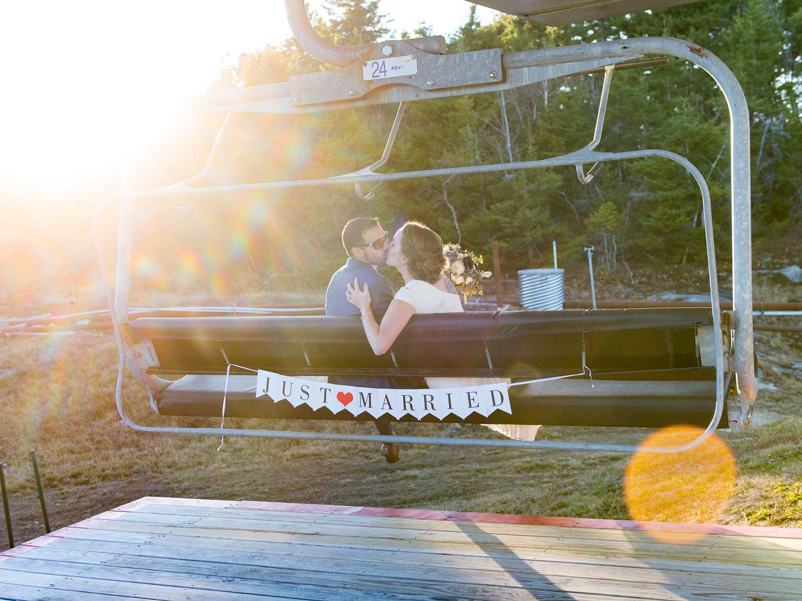 A bride and groom boarding the chairlift.
